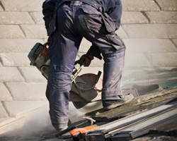 Roofer with work clothing on
